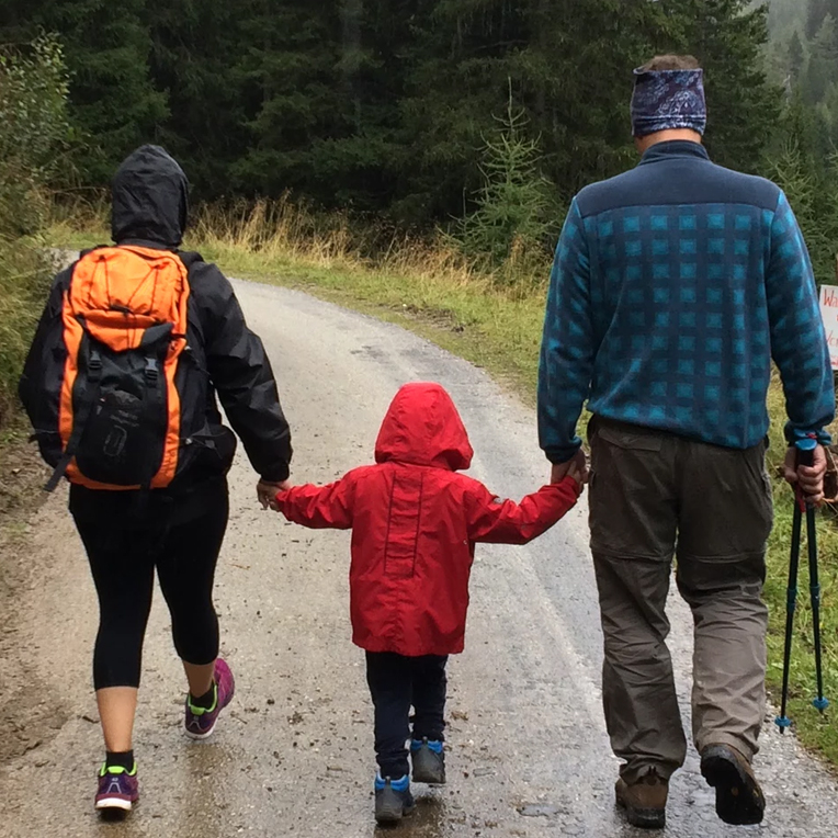 Family with small child on a hike in the rain (alternate) | SungateKids | Child Abuse Awareness, Support & Advocacy